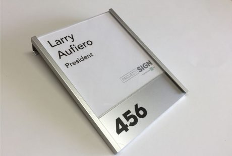 Slide in name plate attaches to Steelcase Cubical Wall