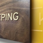 ADA Braille sign walnut wood and laser cut logo