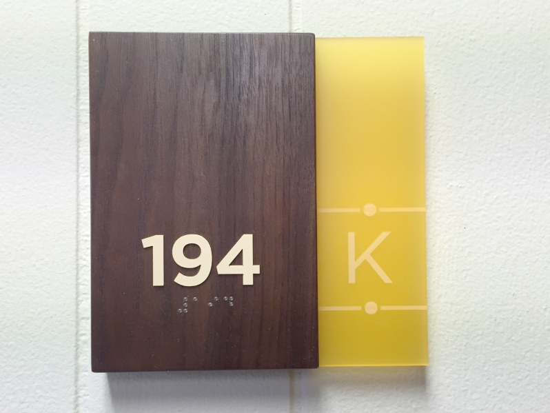 Walnut Wood ADA room sign for Kensington Hotel Laser etched Logo
