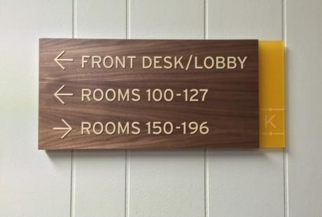 ADA Braille sign walnut wood and laser cut logo
